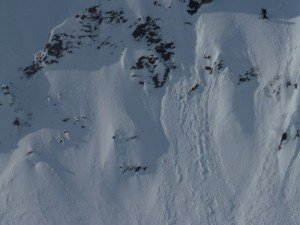 Snowboarder Mike Hardaker (Upper Right) glad to have his Avalung Backpack on Haines Alaska