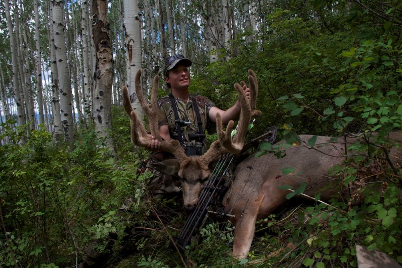 Local hunter Drew Rouse with one of the largest mule deer bucks ever taken with a bow, in Colorado. Photo Ben Koelker | Mountain Weekly News
