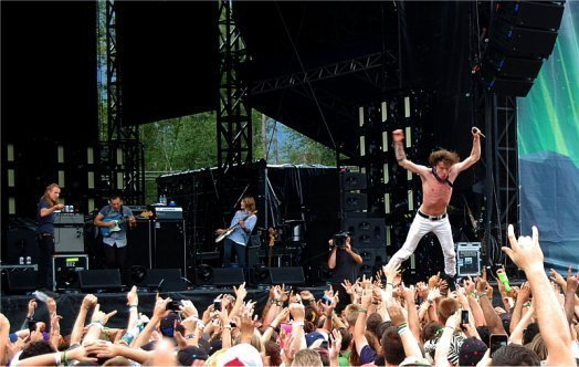 CTE's Matt Shultz dropping in for a second crowd surf during come a little closer. Photo: Jonathan Penfield | Mountain Weekly News