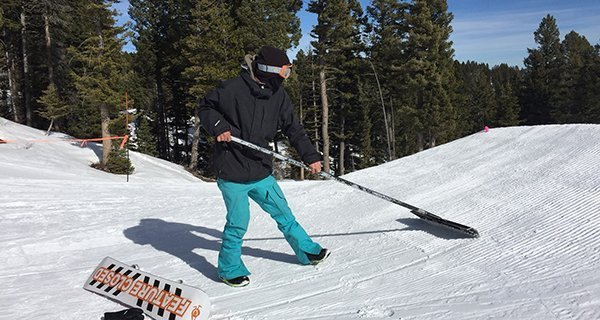 Josh Thompson testing the VonZipper Feenom Goggles while holding down the terrain park at Bridger Bowl