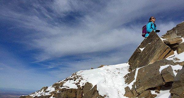 Hannah Trask testing Patagonia Women's Nano Air Hoody high atop the Tetons Photo Mountain Weekly News