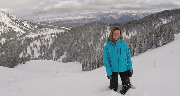 Michelle Sirois enjoying Knee-deep powder atop Edelweiss Bowl while testing the Stio Environ Jacket | Photo Mountain Weekly News