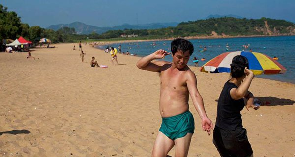 Aug. 11, 2012. Two people dance at Majon beach near Hamhung, North Korea. Photo David Guttenfelder