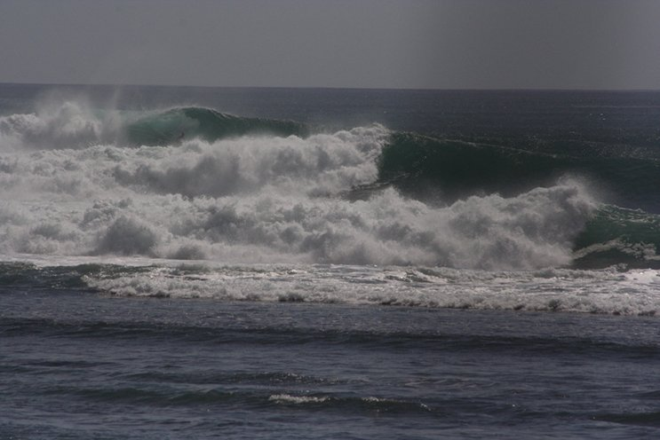 In the last last foam, ball there's a surfer calm and collected with a lot of water moving.  Photo Mike Hardaker   Mountain Wekely News