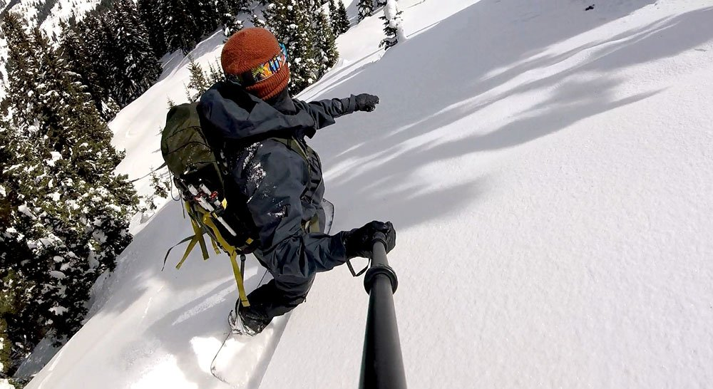 Snowboarding in Patagonia PowSlayer Jacket