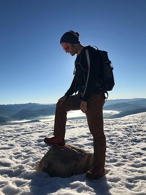 Ryan testing the Lhoste Boot atop the Tetons, Photo Borbay