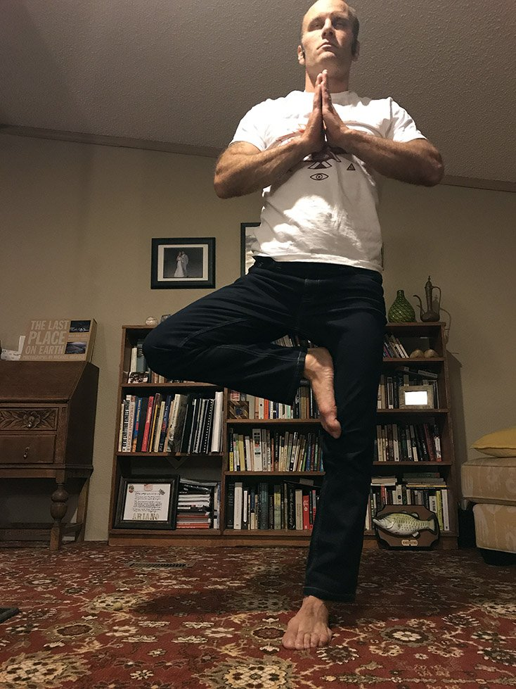 Man doing Yoga in Jeans