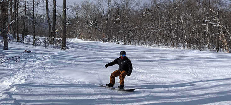 Snowboarder making turn