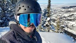 Snowboarder wearing helmet