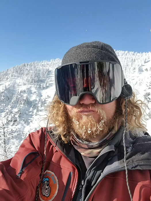 Skier in Goggles on Bluebird Day in the Mountains