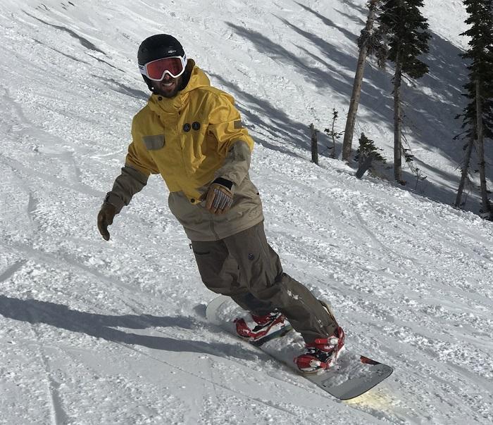 Snowboarder wearing Saga Jacket