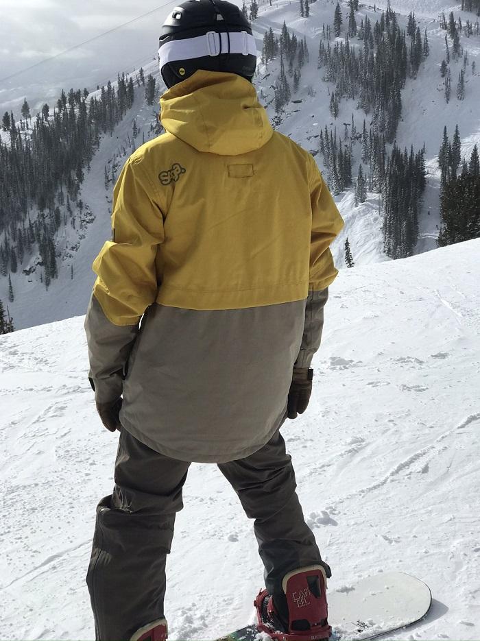 Snowboader wearing Jacket on slopes