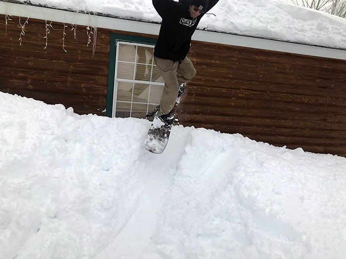 Jumping off Roof on Snowboard