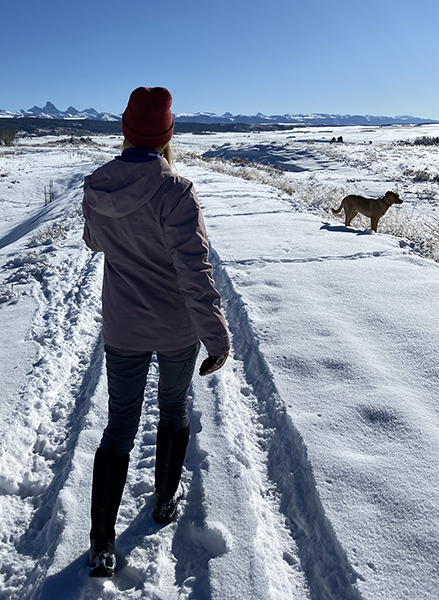 Women walking in Snow with a Dog