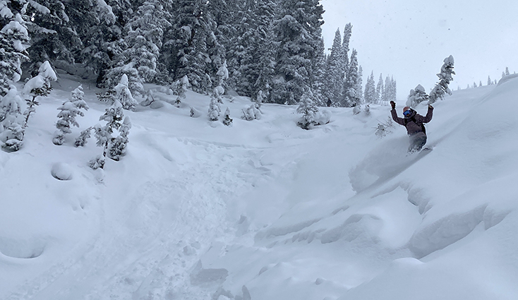 Women Snowboarding Powder with REI Jacket