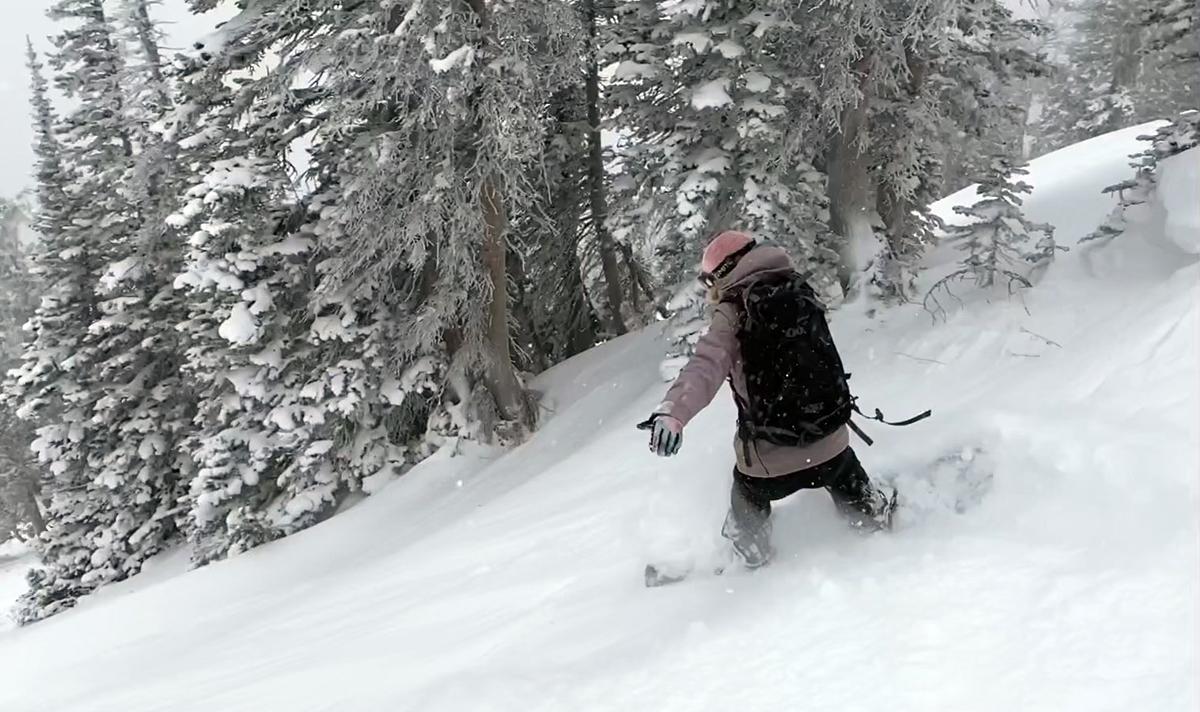 Women Snowboarding Powder