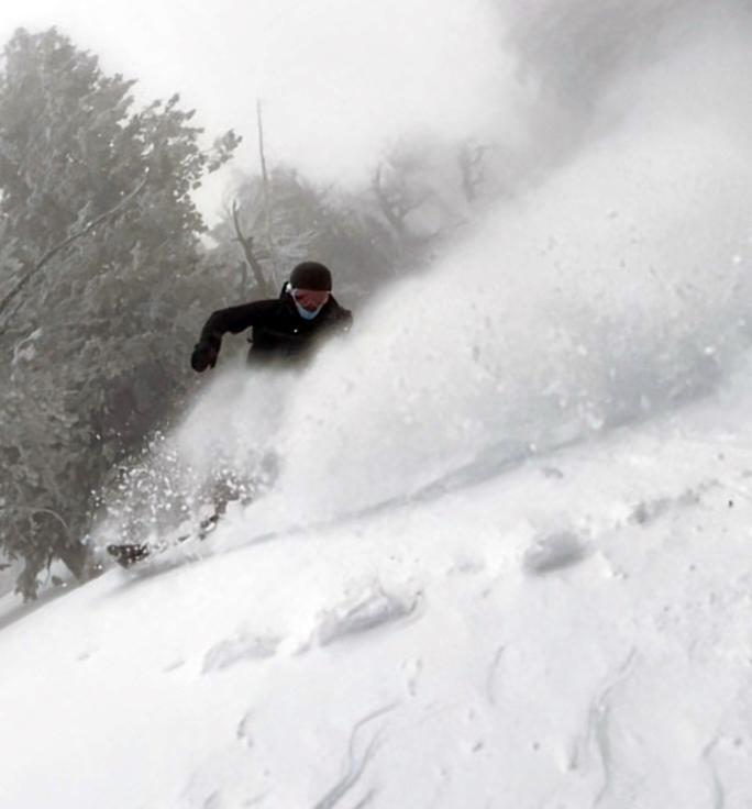REI Snowboard Jacket - Man Riding Powder on Snowboard