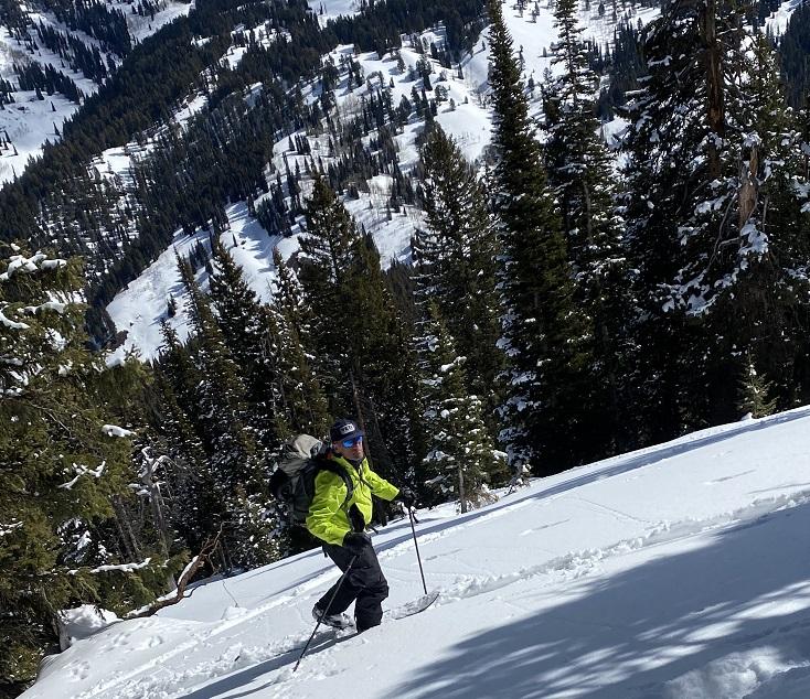 Splitboarder Climbing a Mountain